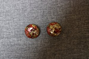 Earclip dark red-gold-colored mixture fibre