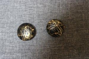 Earclip black-gold-colored mixture fibre