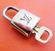 Louis Vuitton Travel Bag gold-colored metal