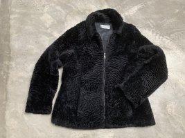 Veste en fourrure noir cuir