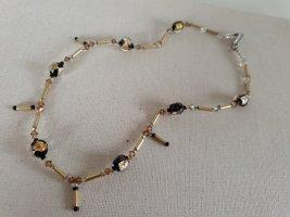 Collier de perles noir-doré