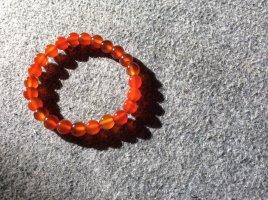 Pulsera naranja oscuro