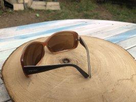 Prada Owalne okulary przeciwsłoneczne ciemnobrązowy-ciemny pomarańcz