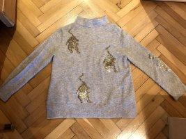 Pullover mit goldenen Raubkatzen