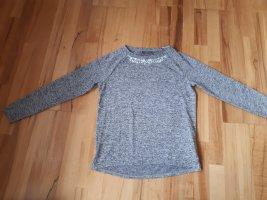 Pullover mit Steinchen