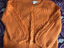 Pullover orange mit Lochmusster
