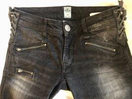 Replay-Jeans in washed Optik mit Leder-Details