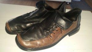 Rieker Pantoffels zwart-cognac Leer