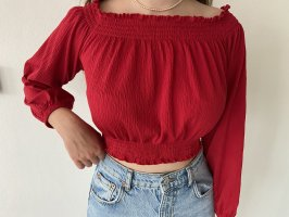 rote schulterfreie Bluse