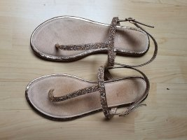 Sandalen mit Glitzersteinen