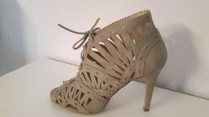 Sandalette, Zign