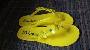 Schicke Flip Flop , Zehentreter in Gelb mit Blumen und Steinen
