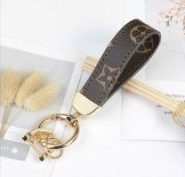 Schicker Schlüsselanhänger Leder braun golden NEU