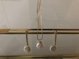 Orecchino di perle bianco-oro