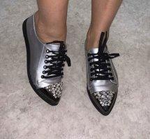 Zapatos brogue color plata-negro