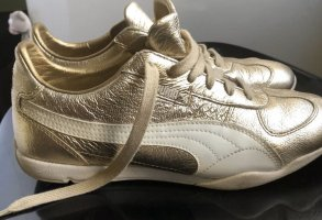 Schöne Puma Sneaker Schuhe Leder in gold Gr. 39