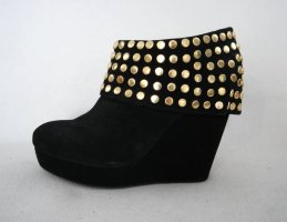Schöne Stiefeletten mit Wedgeabsatz aus schwarzem Leder mit gold