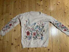 Schöner bestichter Pullover