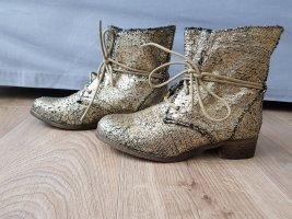 Botas con cordones color oro
