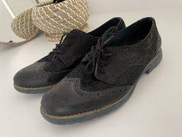 Schuhe in schwarz mit Muster