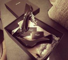 Saint Laurent Zapatos de punta negro Cuero