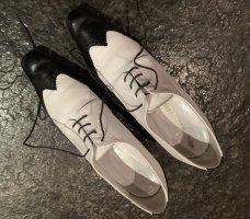 Zapatos brogue blanco-negro Cuero