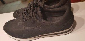 Schwarze glitzerne Schuhe