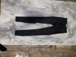 Schwarze High Waist Jeans mit Löchern