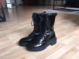 Schwarze Lack Boots