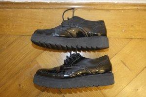 Schwarze Plateau Schuhe