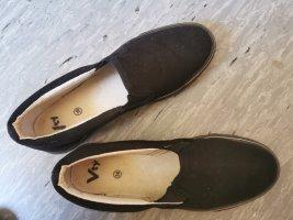 schwarze Plateu Schuhe