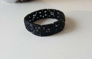Schwarzes Armband, mit Muster und Steinchen, Bijou Brigitte