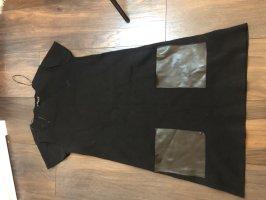 Schwarzes oversize Kleid