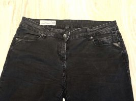 Skinny Jeans raw edges mit Lederdetails