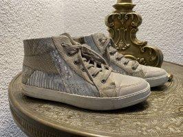 Sneaker in gold und silber