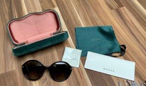 Gucci Ronde zonnebril bruin