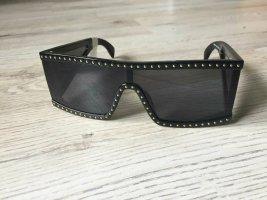 Moschino Occhiale da sole spigoloso nero-oro Acetato