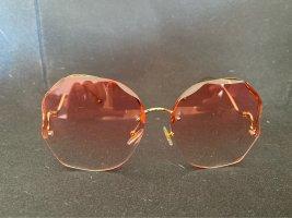Lunettes de soleil ovales rosé-doré