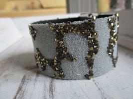 Bracelet de bras blanc-bronze