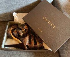 Gucci Sandalo con plateau marrone-oro Pelle di rettile