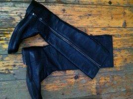 Prada Botas de invierno negro Cuero
