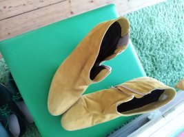 Andrea Conti Zipper Booties yellow