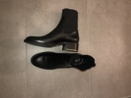 Zara Botas deslizantes negro-color oro