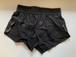 H&M Pantalón corto deportivo negro-color oro