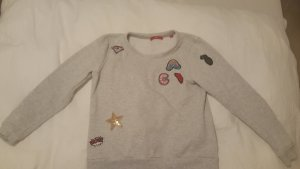 stylischer Sweater mit Patches