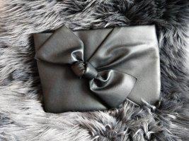Süße schwarze Tasche mit Schleife Reserved