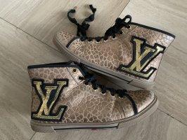 Louis Vuitton High top sneaker goud-zwart Leer
