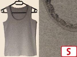 Camiseta sin mangas gris-color plata