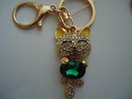 Porte-clés doré-vert gazon