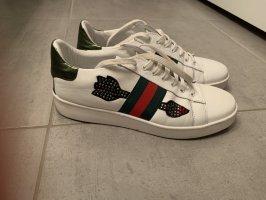 The Seller Sneaker bestickter Pfeil 39
